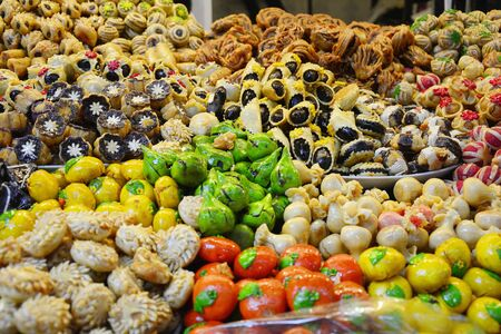 Morocco, with different sweets shop in the souk of Marrakesh