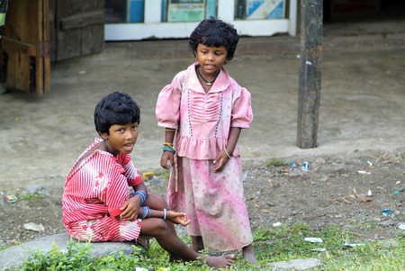 Assam, India - September 30th, 2007: Unidentified female children in poorly and dirt clothes, Indian inhabitants on the border to Bhutan