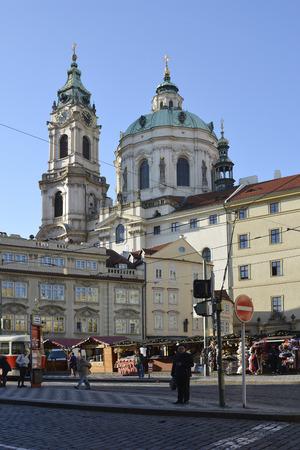 Prague, Czech Republic - December 3rd 2015: Unidentified people, Christmas market and Saint Nicholas church on Malostranske square