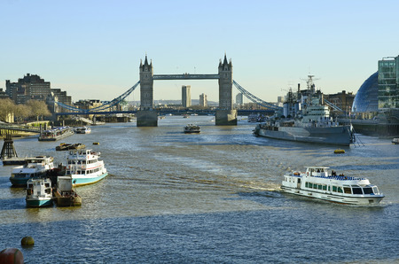 London, United Kingdom - January 15th 2016: River thames with Tower bridge and warship HMS Belfast