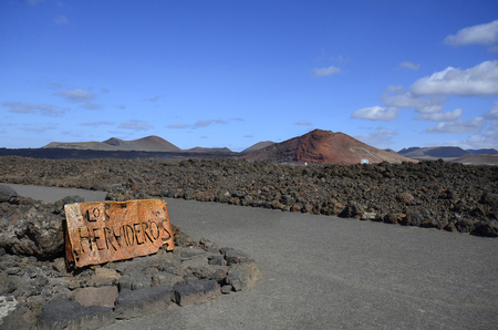spain, sign to the natural spectacle and tourist attraction Los Hervideros on Lanzarote