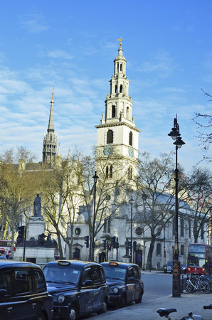 London, United Kingdom - January 19th 2016: Unidentified people and traffic around Saint Mary le Strand church with Gladstone memorial