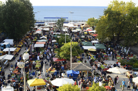 Kavala, Greece - September 22nd 2012: people at the weekly street market for fruits and vegetables
