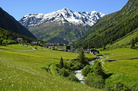 Plangeross, Austria - June 23rd 2016: Tiny village in Pitztal with snowy Tyrolean alps in background, preferred area for skiing and hiking