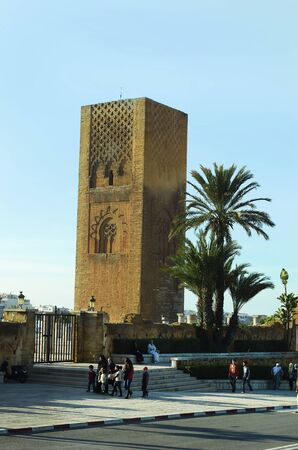 Rabat, Morocco - November 18th 2014: Unidentified tourists sightseeing the place of Hassan tower - landmark of the city
