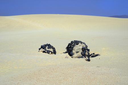 Spain, Canary Island, Fuerteventura, lava rock in the dunes of nature park El Jable