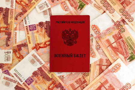 Russian military card on the background of five thousandth banknotes