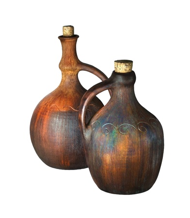 Old ceramic wine jugs isolated on white