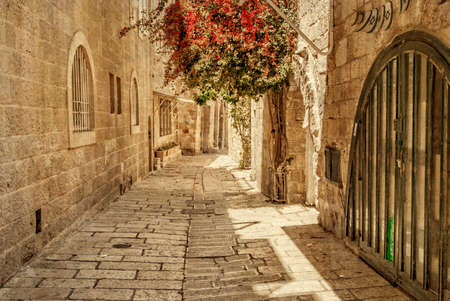 Ancient Alley in Jewish Quarter, Jerusalem. Israel. Photo in old color image style.