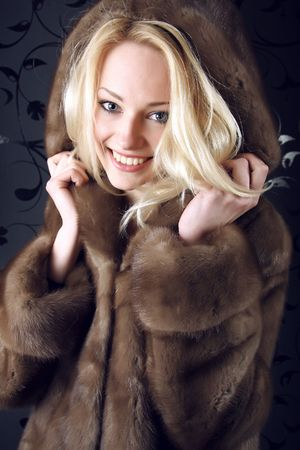Smiling Winter Woman. Photo.
