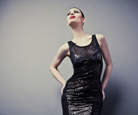 Beautiful woman on black classical dress pose in studio  Vogue style photo