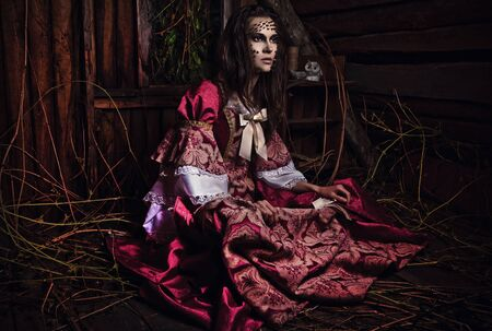 of a young fashion lady in a dark mystic location