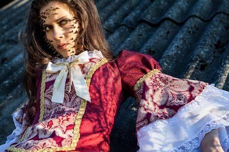a young fashion lady in a dark mystic location