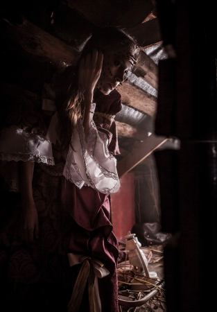 Fine art image of a young fashion lady in a dark mystic location