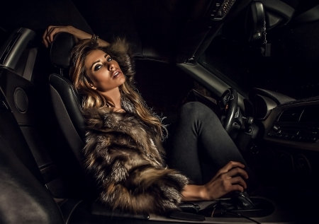 Photo for Luxury woman in a car   - Royalty Free Image