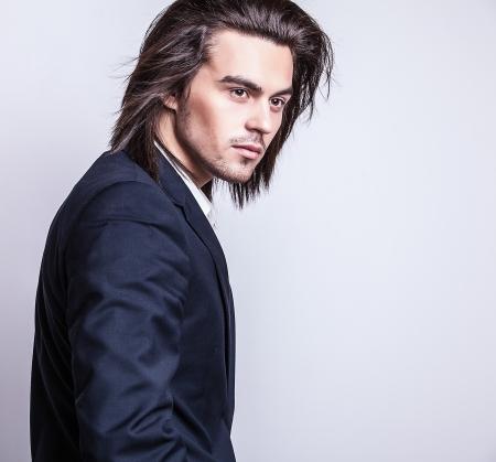 Photo pour Portrait of handsome long-haired stylish man    - image libre de droit