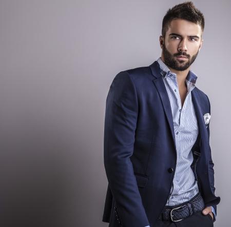 Foto de Elegant young handsome man  Studio fashion portrait   - Imagen libre de derechos
