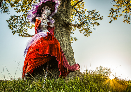 Fairy tale woman on stilts in bright fantasy stylization. Fine art outdoor photo.