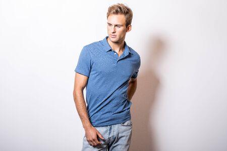 Photo pour Elegant young handsome man in stylish blue shirt. - image libre de droit