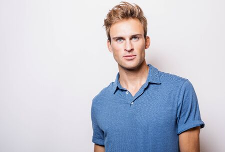 Photo for Elegant young handsome man in stylish blue shirt. - Royalty Free Image