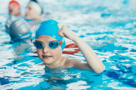 Photo pour young and successful swimmers pose - image libre de droit
