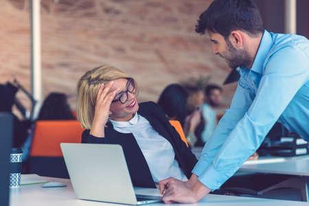 Foto de Happy business partners working on laptop. Teamwork, co-working concepts. - Imagen libre de derechos