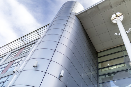 Photo pour Grey or silver cladding gives an ultra modern and contemporary architectural feel to a building - image libre de droit