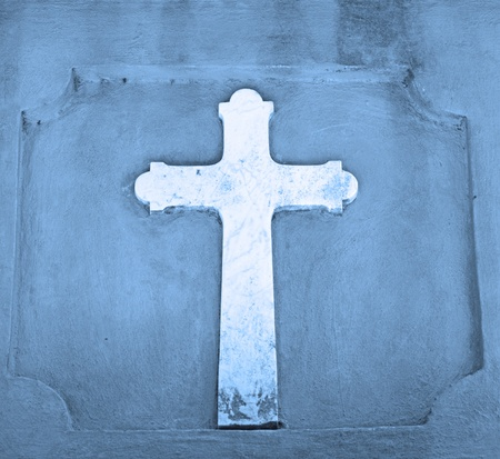 christian cross in blue to represent religion