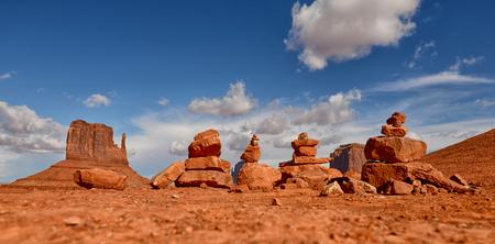 Stacks of prayer rocks or cairns lined up in Monument Valley desert