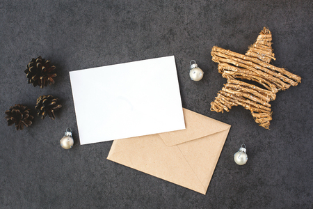 Card and envelope with Christmas decorations, top view