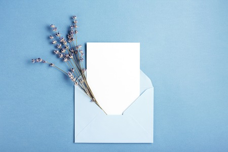 Foto de Mockup with card and lavender in blue envelope. Top view. - Imagen libre de derechos