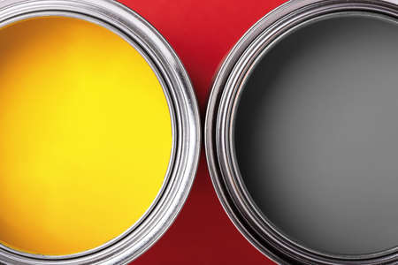 Photo for Cans of yellow and gray paint on red background. Top view, minimal. - Royalty Free Image