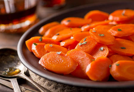 A plate of delicious maple glazed carrots with thyme.
