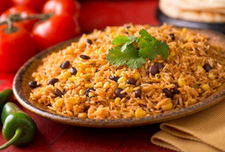 Foto für A plate of delicious authentic Mexican Rice with black beans, corn, garlic, and cilantro. - Lizenzfreies Bild