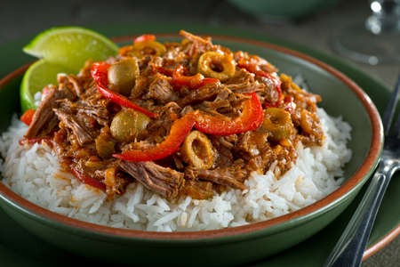 Photo for A delicious cuban ropa vieja stew on a bed of rice with lime garnish. - Royalty Free Image