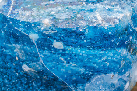 Quartz stone, glass stone pieces in blue as decoration for home and garden