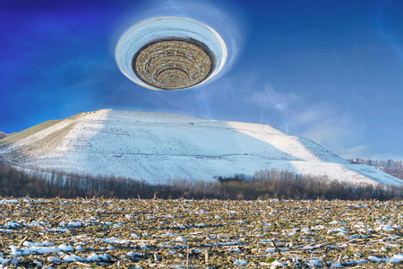 Photomontage, landscape picture of a snowy mountain over it a giant hurricane