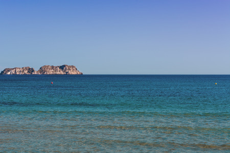 Views of the Bay of Paguera with a sandy beach and azure waters, Mallorca, Spain.