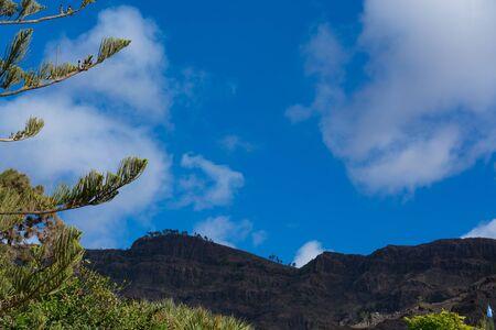 Mountains on the coast between Puerto de Mogan and Puerto Rico. Layers of volcanic rock.