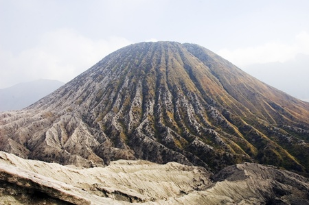 Batok cone and its deep radial erosion gullies in Bromo volcan caldeira, java, indonesia