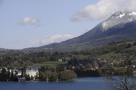 View of Annecy city and lake with snowed mountains, in France