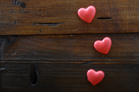 Photo pour Three red heart on wooden background for valentine - image libre de droit