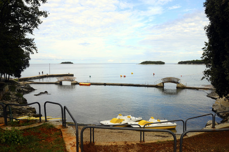 Beach landscape in Croatia, with quiet sea, kayaks and pedal boat, Europ