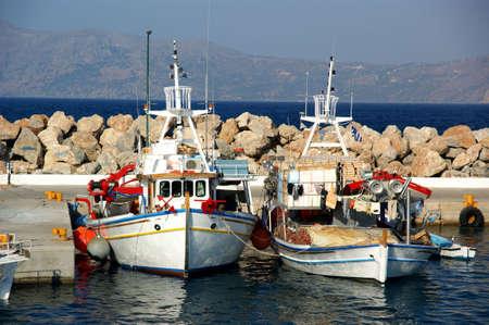 Fishing boats in a Mediterranean port.