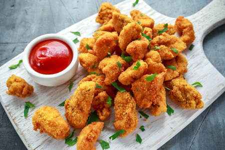 Foto für Fried crispy chicken nuggets with ketchup on white board - Lizenzfreies Bild