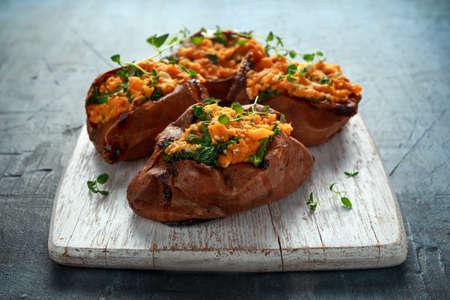 Foto für Roast sweet potato stuffed with feta cheese and kale. healthy food - Lizenzfreies Bild