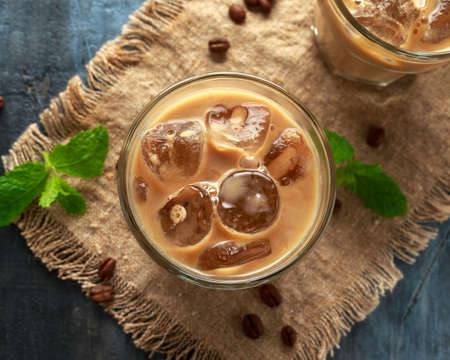 Foto de iced latte coffee in a glass with cold milk. Summer drink - Imagen libre de derechos