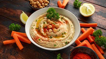 Photo pour Hummus with olive oil, paprika, lemon and carrot. - image libre de droit