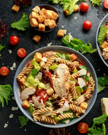 Photo for Caesar Salad Pasta with chicken, tomato, parmesan cheese and vegetables - Royalty Free Image