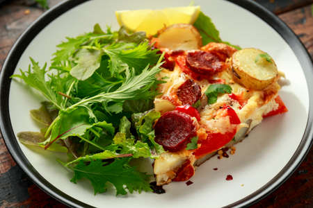 Photo for Chorizo Frittata with salad on black and white plate. healthy morning breakfast food - Royalty Free Image